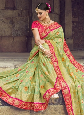 Banarasi Silk Mint Green and Rose Pink Trendy Classic Saree