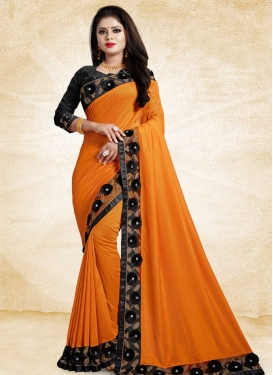 Art Silk Black and Orange Trendy Saree For Ceremonial