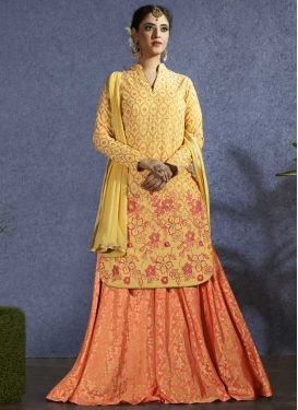 Aari Work Peach and Yellow Kameez Style Lehenga