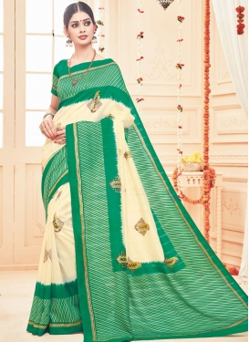 Absorbing Cream and Green Print Work  Classic Saree