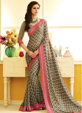 Affectionate Beige And Brown Color Lace Work Casual Saree