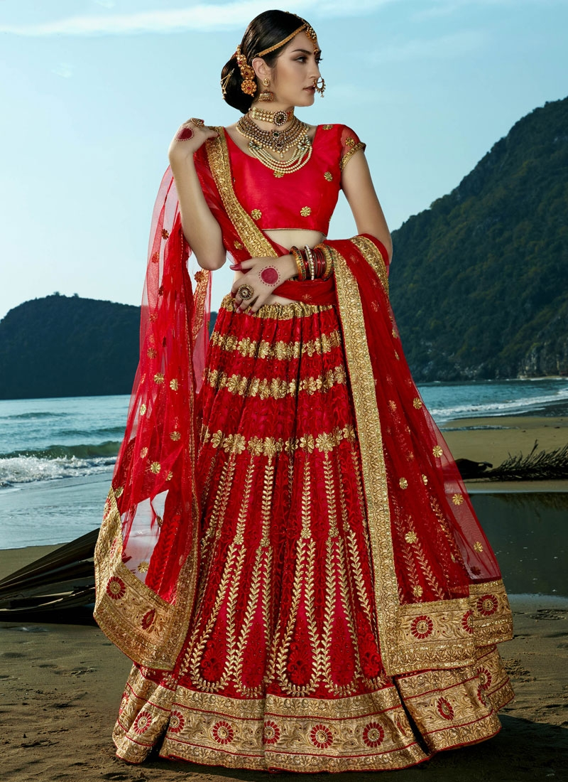 Affectionate Patch Border Work Net Bridal Lehenga Choli