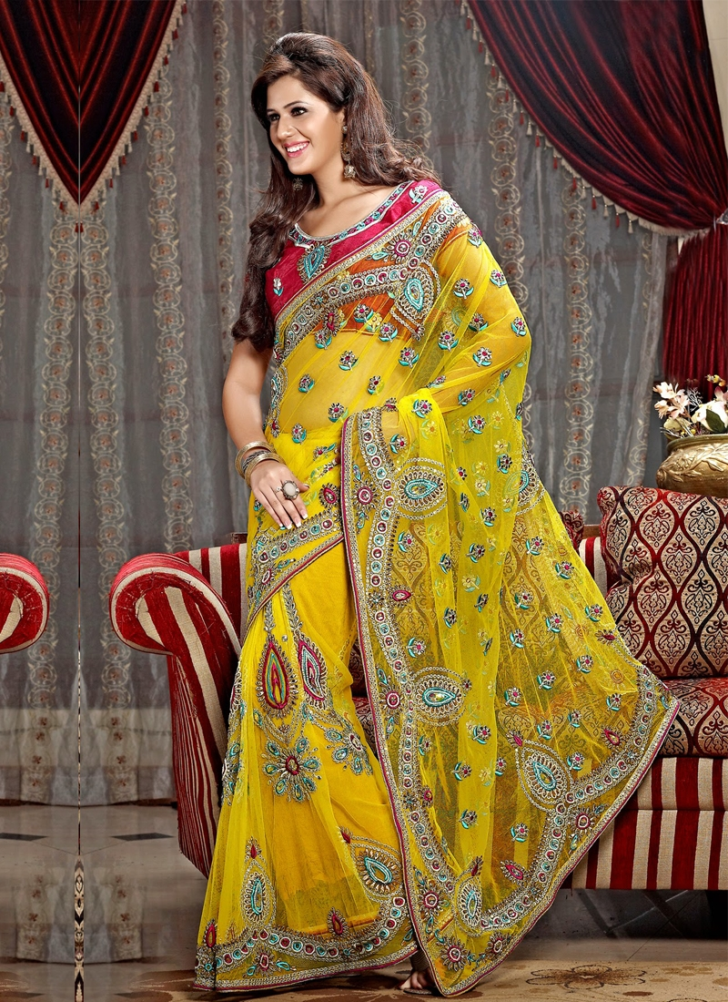 Alluring Multi Work Yellow Color Net Wedding Saree