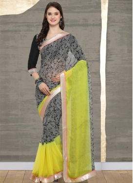 Aloe Veera Green and Black Faux Georgette Classic Saree