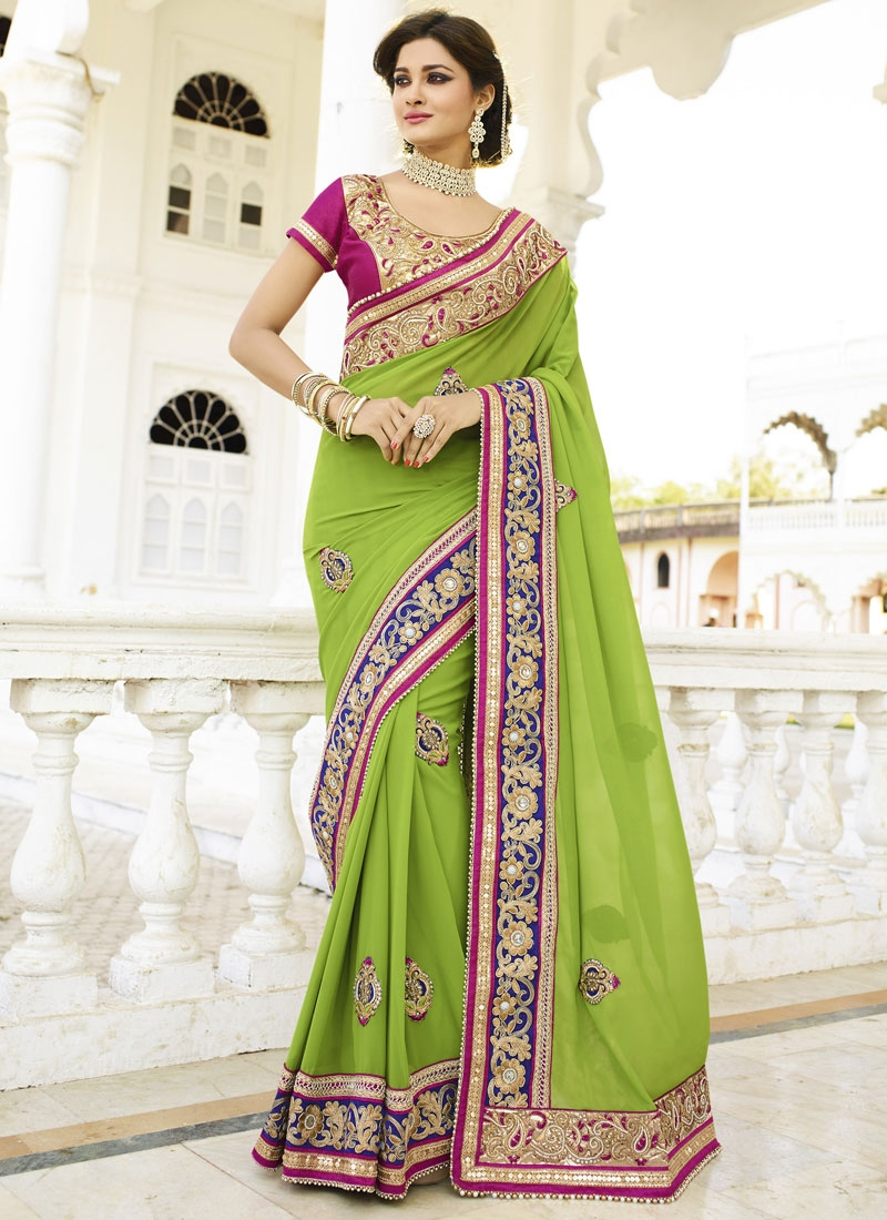 Amusing Booti And Stone Work Wedding Saree