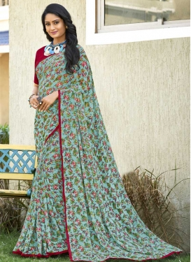 Aqua Blue and Maroon Faux Georgette Trendy Saree