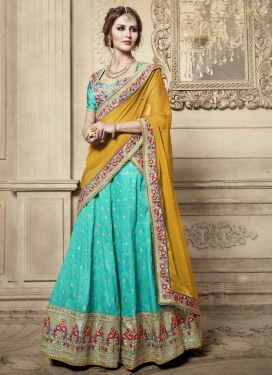 Aqua Blue and Mustard Silk A Line Lehenga Choli For Festival