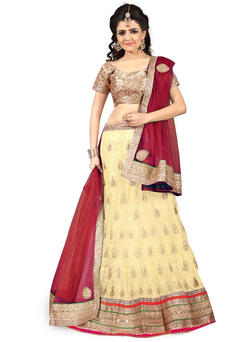 Aristocratic Mirror Work Cream Color Wedding Lehenga Choli