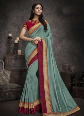 Art Silk Aqua Blue and Red Trendy Classic Saree