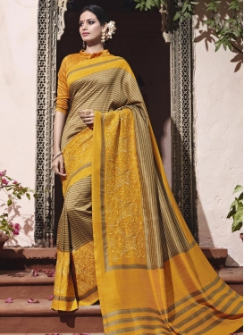 Art Silk Beige and Orange Embroidered Work Classic Saree