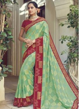 Art Silk Crimson and Sea Green Trendy Classic Saree