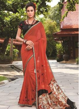 Art Silk Embroidered Work Black and Orange Trendy Classic Saree