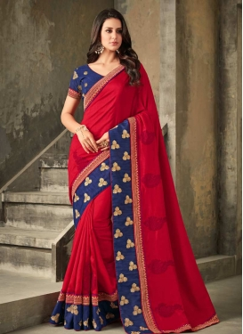 Art Silk Navy Blue and Red Classic Saree