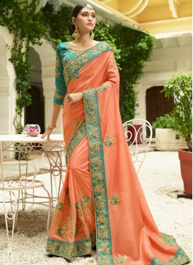 Art Silk Peach and Turquoise Trendy Classic Saree