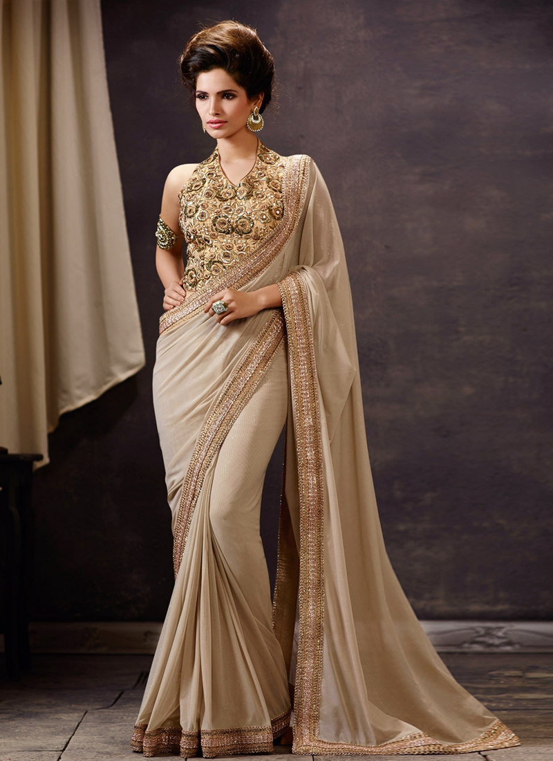 Auspicious Beige Color Net Designer Saree
