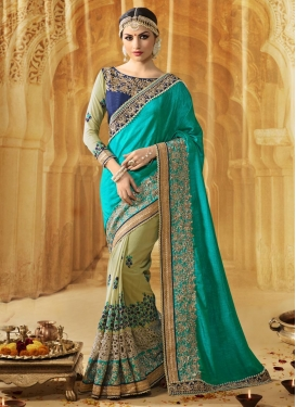 Beauteous Patch Border Work Olive and Turquoise  Half N Half Designer Saree