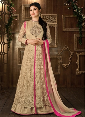 Beautiful Mouni Roy Embroidered Work Beige Fancy Fabric Floor Length Designer Suit