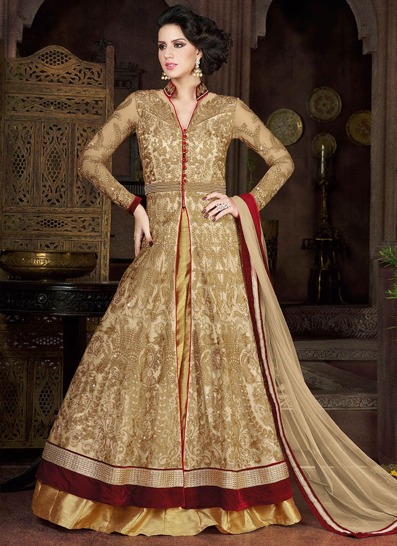 Beckoning Stone Work Beige Color Net Wedding Lehenga Choli