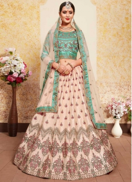 Beige and Turquoise Embroidered Work Lehenga Choli