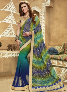 Blue and Sea Green Faux Georgette Trendy Classic Saree For Festival