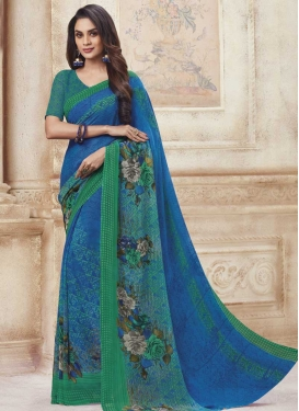 Blue and Sea Green Print Work Faux Georgette Classic Saree