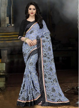 Brasso Georgette Black and Light Blue Trendy Saree For Ceremonial