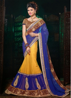 Breathtaking Yellow And Blue Color Booti Work Lehenga Saree