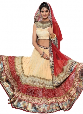 Capricious Cream Color Stone Work Designer Lehenga Choli