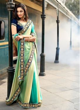 Capricious Jacquard Stone Work Party Wear Saree