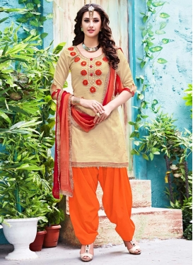 Captivating  Beige and Orange Beads Work Patiala Salwar Kameez