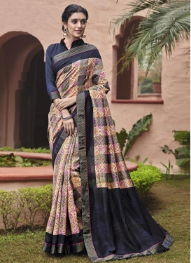 Captivating Cream and Navy Blue Art Silk Traditional Saree