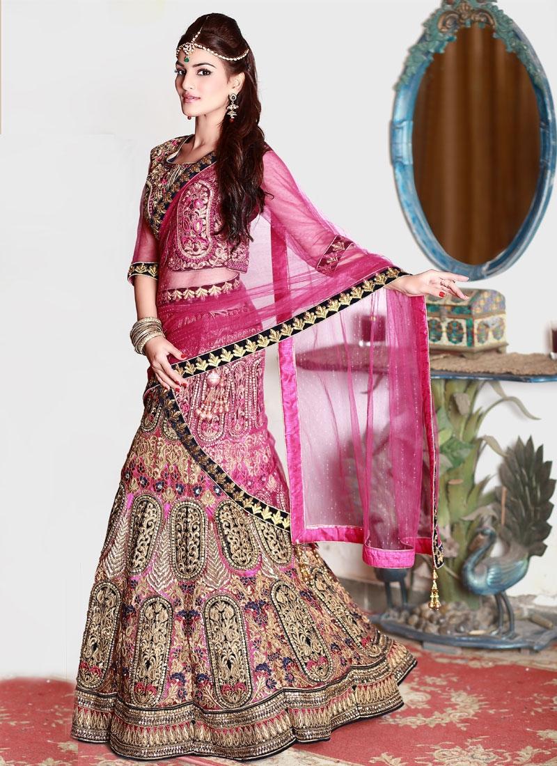 Charismatic Resham Work Velvet And Net Bridal Lehenga Choli
