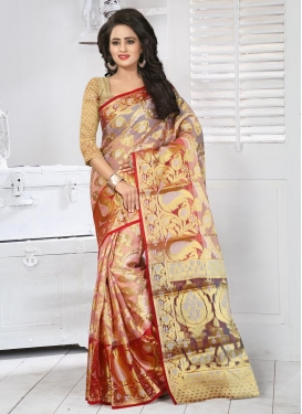 Charismatic Tissue Beige and Salmon Resham Work Traditional Saree