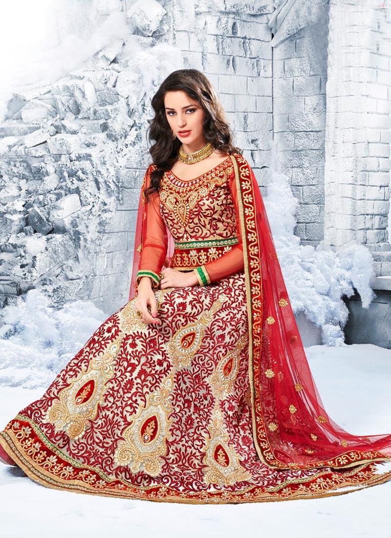 Cherubic Cream Color Net Wedding Lehenga Choli