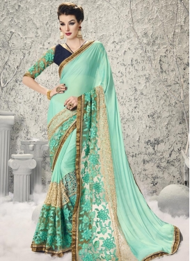 Classy  Beige and Turquoise Net Embroidered Work Designer Traditional Saree