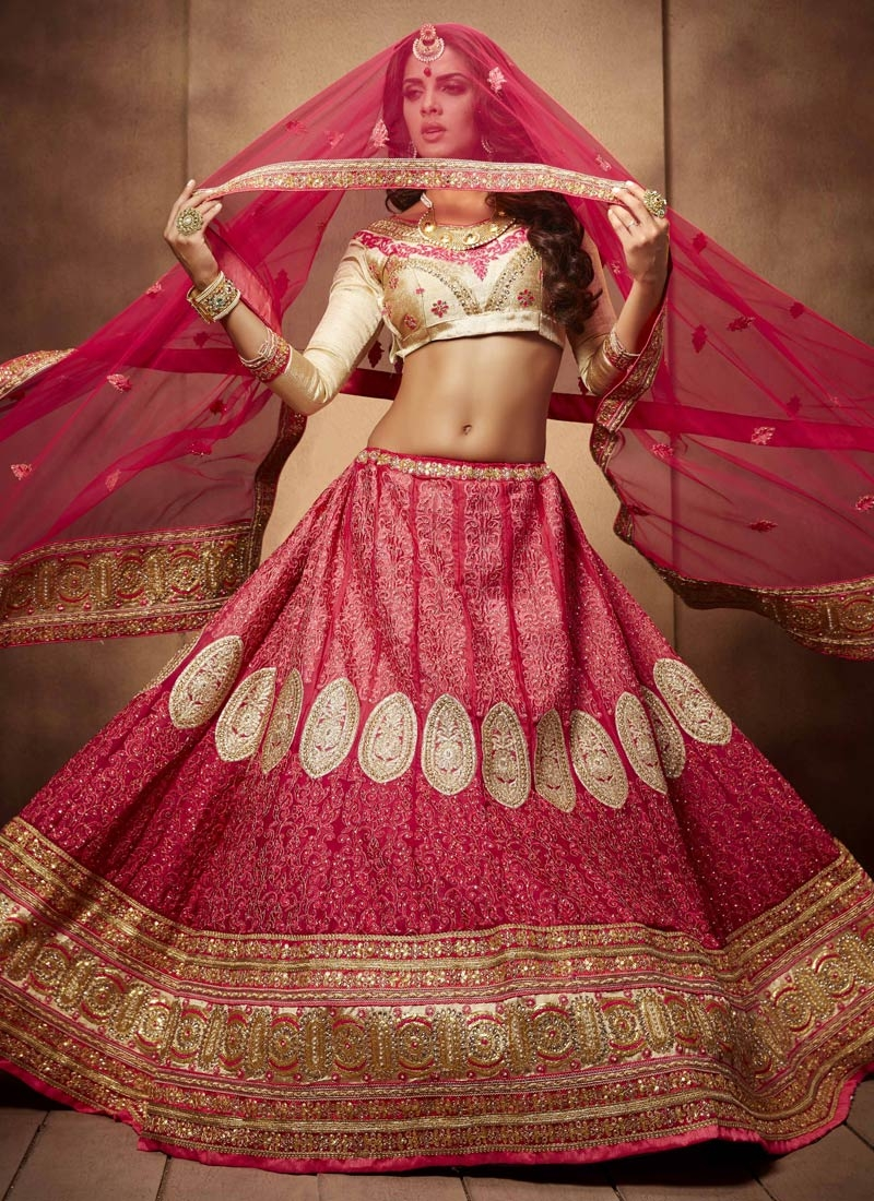 Compelling Embroidery And Booti Work Bridal Lehenga Choli