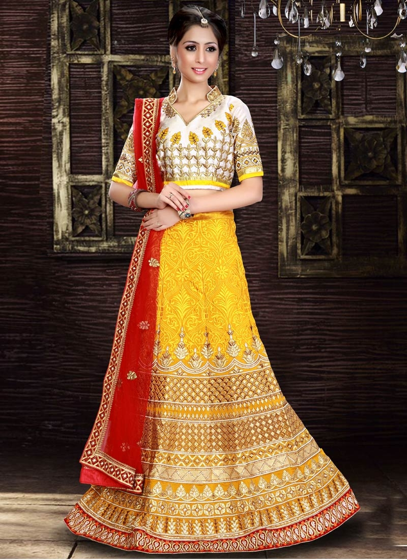 Compelling Stone Work Yellow Color Bridal Lehenga Choli