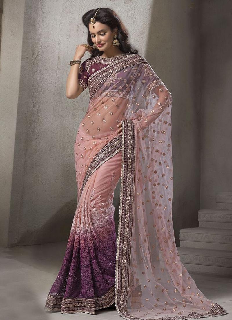 Congenial Purple Color Net Wedding Saree