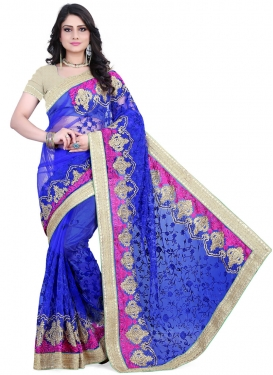 Conspicuous Blue Color Net Embroidery Work Wedding Saree