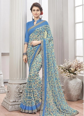 Cream and Light Blue Lace Work Contemporary Saree