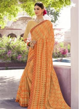 Cream and Orange Lace Work Classic Saree