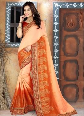 Cream and Orange Trendy Classic Saree For Party