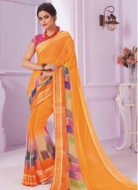 Cream and Orange Trendy Saree For Ceremonial