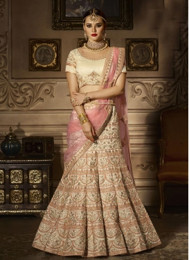 Cream and Salmon Embroidered Work A Line Lehenga Choli