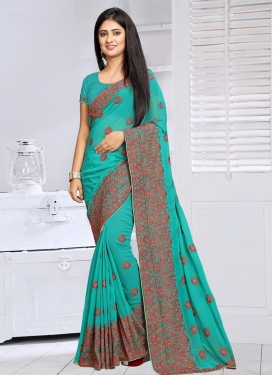 Dazzling Embroidered Work Faux Georgette Trendy Saree