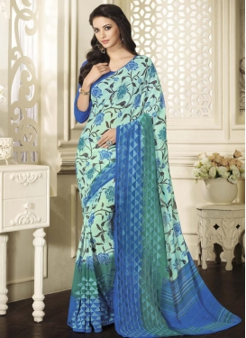 Deserving Blue and Teal Faux Georgette Traditional Saree