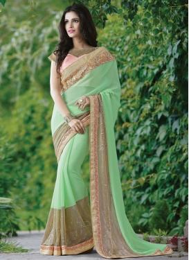 Dignified Mint Green Color Lycra Designer Saree