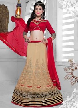 Dilettante Patch Border Work Net Wedding Lehenga Choli