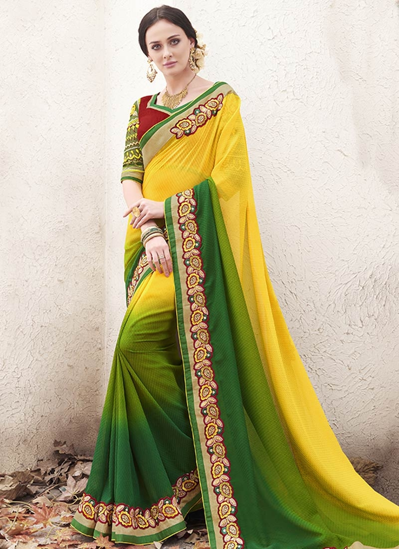 DistinctiveLace And Stone Work Green Color Party Wear Saree