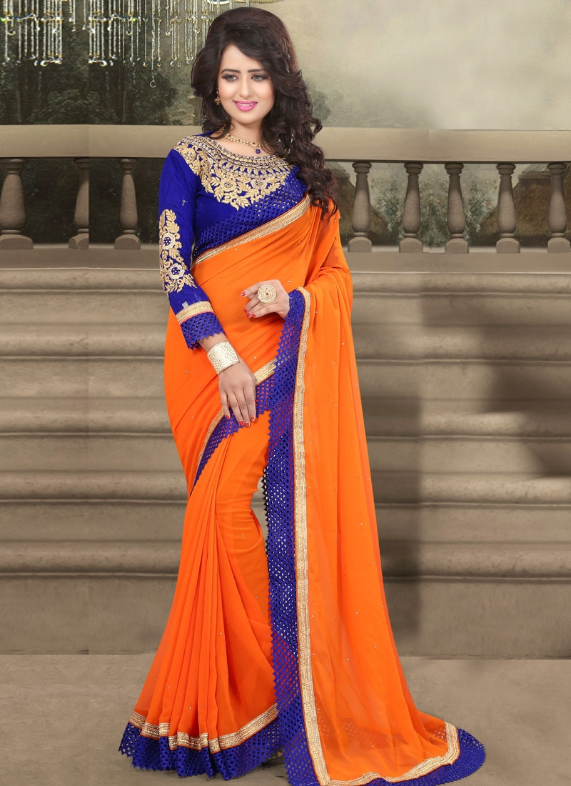 Distinctive Orange Color Stone Work Party Wear Saree